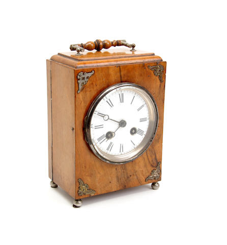 A late Victorian walnut timepiece
