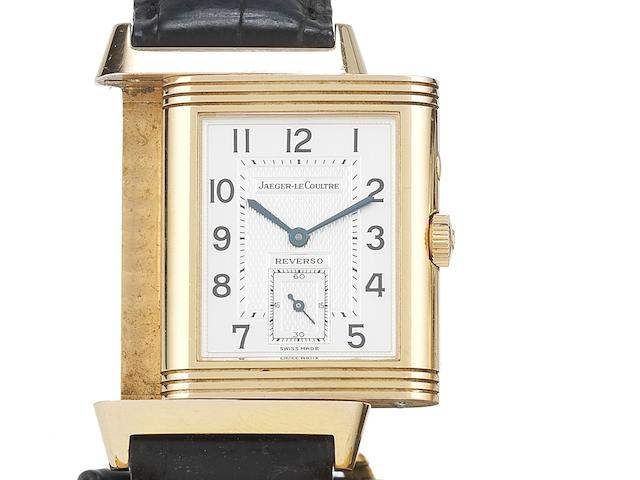 Jaeger LeCoultre. An 18ct rose gold manual wind reversible wristwatch with box and papers Reverso Day and Night, Ref:270.2.54, Case No.2027666, Sold 23rd December 2000