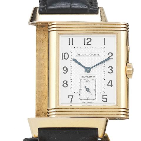 Jaeger LeCoultre. An 18ct rose gold manual wind reversible wristwatch with box and papersReverso Day and Night, Ref:270.2.54, Case No.2027666, Sold 23rd December 2000