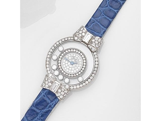 Chopard. A lady's 18ct white gold diamond set quartz wristwatchHappy Diamonds, Ref:2075020-4097/1, Case No.556488, Circa 2000