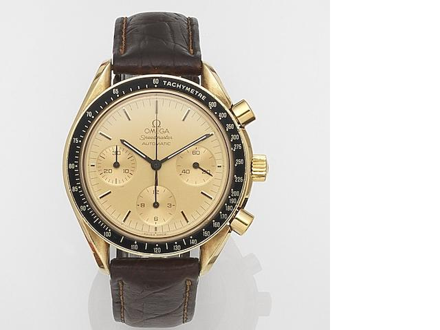 Omega. An 18ct gold automatic chronograph wristwatch Speedmaster, Circa 2005