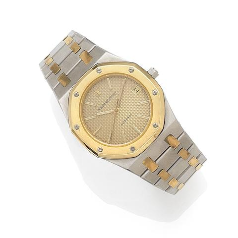 Audemars Piguet. A stainless steel and gold automatic calendar bracelet watchRoyal Oak, No.2087, Case No.B43894, Movement No.244245, Circa 1980