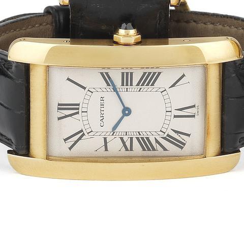 Cartier. An 18ct gold manual wind wristwatchTank Américaine XL, Ref:1735 1, Case No.C55177, Movement No.9302980, Circa 2000