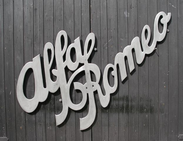 An Alfa Romeo garage display emblem,