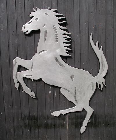A Ferrari Prancing Horse garage display emblem,