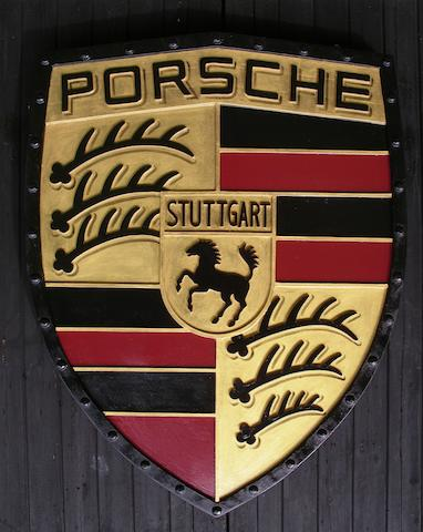 A hand-painted Porsche garage display shield,