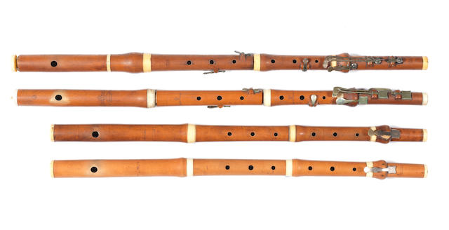 Four English boxwood and ivory Flutes, early 19th century, by Potter, D'Almaine & Co, Goulding & Co and Oppenheim (5)