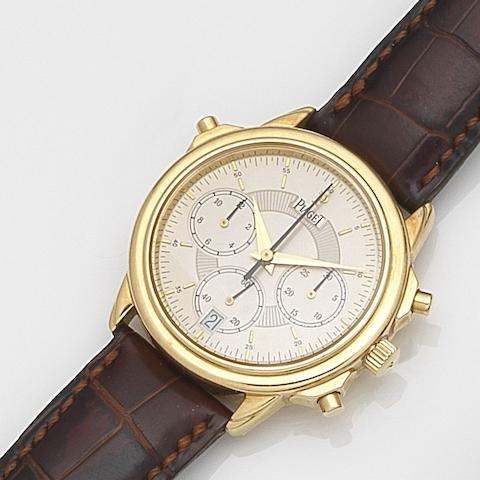 Piaget. An 18ct gold automatic split seconds calendar chronograph wristwatch Circa 2000