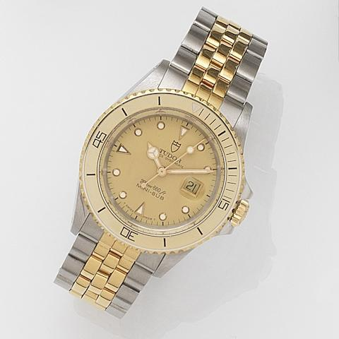 Tudor. A lady's stainless steel and gilt automatic calendar bracelet watch with box and papers Mini-Sub, Ref:73091, Case No.B440642, Sold 30th January 2003