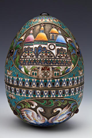 A silver and enamel novelty egg bearing pseudo Russian marks