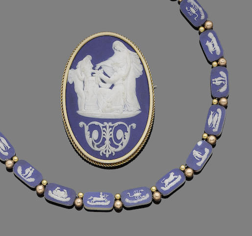 An early 19th century Wedgwood blue jasperware necklace and brooch (2)