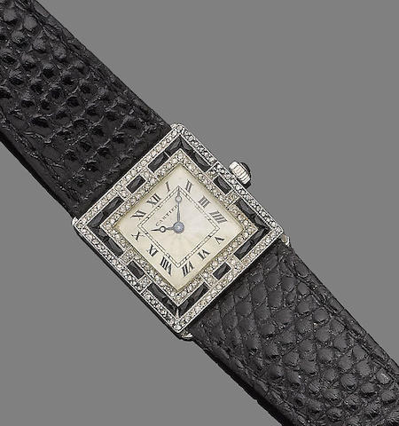 An art deco onyx and diamond wristwatch, by Cartier,
