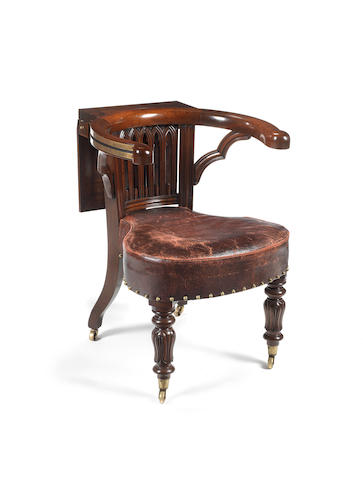 A George IV carved mahogany reading chair attributed to Morgan and Saunders