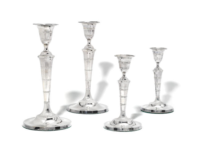 A suite of four George III silver candlesticks by Matthew Boulton, Birmingham 1793  (4)