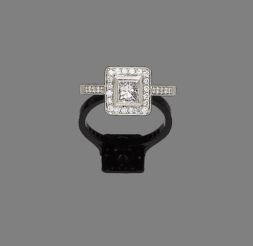 A fancy coloured diamond and diamond cluster ring
