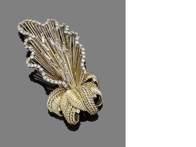 A diamond-set floral brooch,