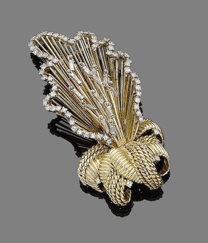 A diamond-set floral brooch,