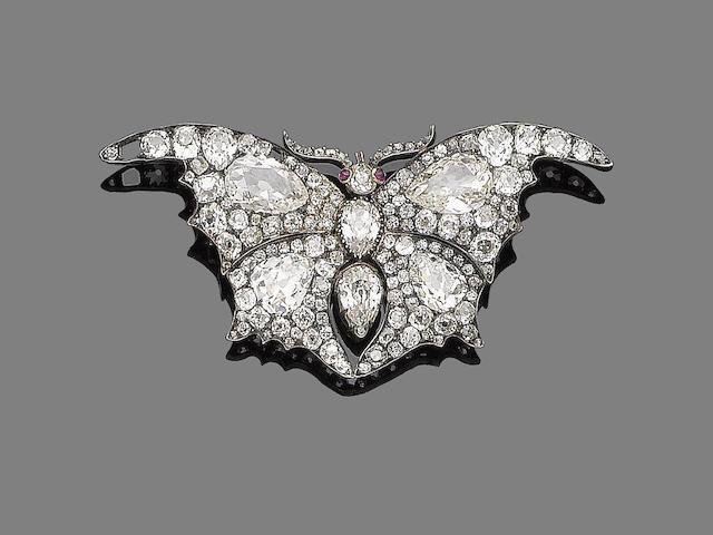 A diamond and ruby brooch,
