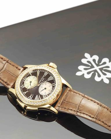 Patek Philippe. A fine and rare 18ct rose gold, diamond set and mother-of-pearl dual time zone lady's manual wind wristwatchCalatrava Travel Time, Ref:4934R, Case No.4423157, Movement No.3705124, Sold in February 2008