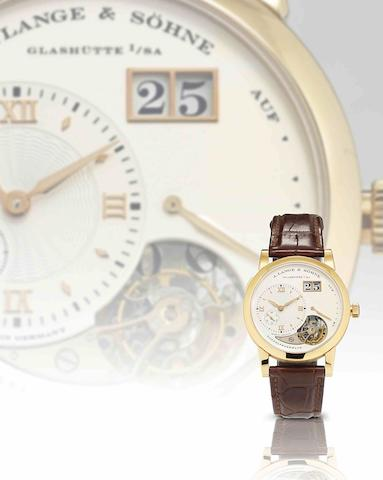 A. Lange & Söhne. A very rare and important limited edition 18ct honey gold calendar tourbillon manual wind wristwatch with power reserve Lange 1 Tourbillon Homage to F.A. Lange, Ref:722.050, Sold in August 2012