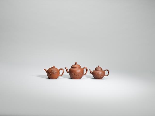 Three appliqué-decorated teapots and covers Early Qing dynasty