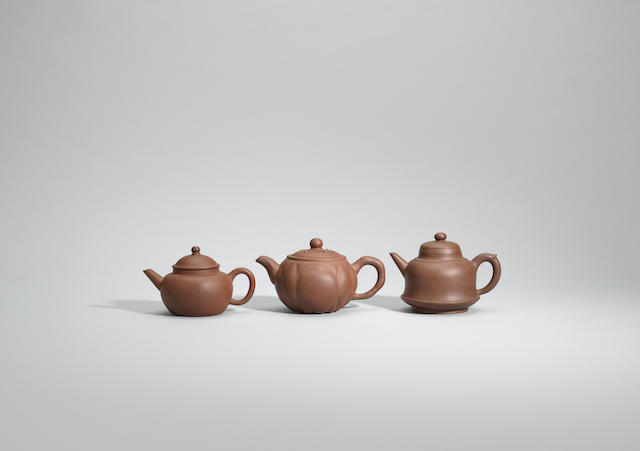Three Yixing stoneware teapots and covers Late Qing/early Republican