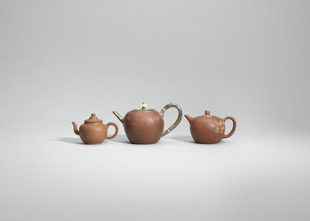 Three Yixing stoneware teapots and covers Early Qing dynasty