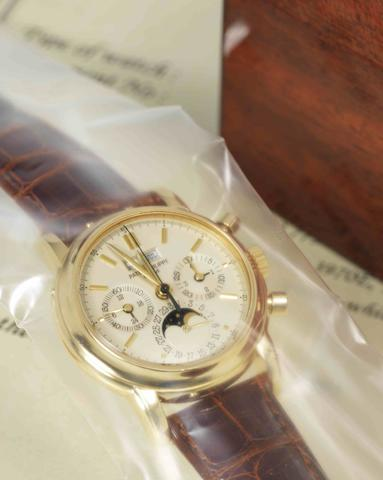 Patek Philippe. A very fine and rare 18ct gold chronograph perpetual calendar manual wind wristwatch Ref:3970E, Case No.2873775, Movement No.875923, Made in 1991