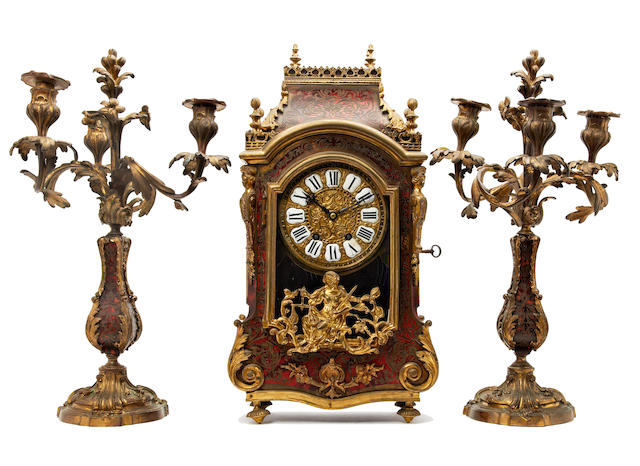 Regence style boulle mantel clock and associate candelabra (clock with two keys and pendulum)