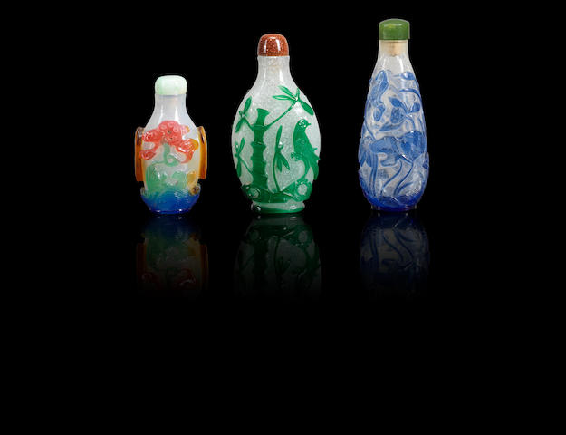 Three overlay glass snuff bottles Qing dynasty