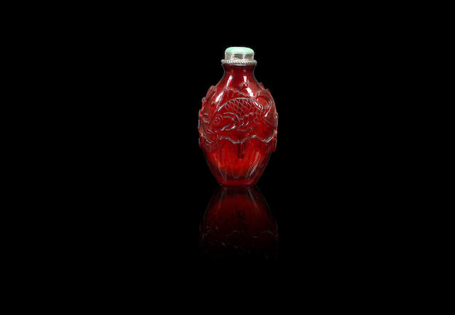 A rare 'fish and lotus' glass snuff bottle Qing dynasty, 18th century