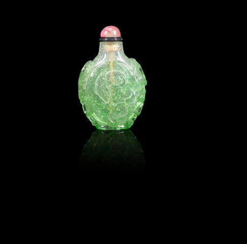 A transparent emerald-green and colourless glass 'chi dragons' snuff bottle Qing dynasty, 1730-1770