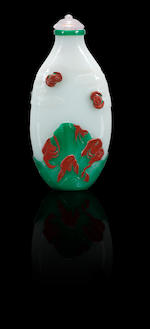 A cinnabar-red and emerald-green glass overlay 'crane and bats' snuff bottle Yangzhou, 1830-1890