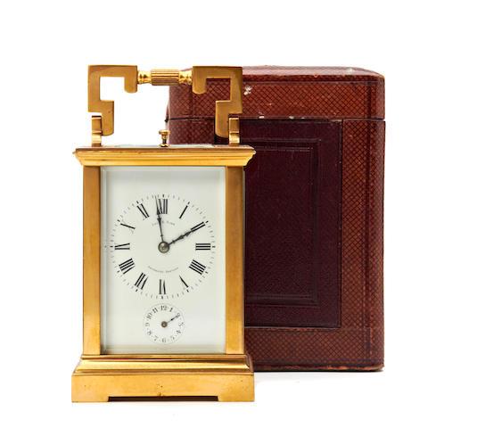 An early 20th century gilt cased quarter striking carriage clock Retailed by Lois E Sinn, Valparaiso, Santiago