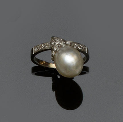 A natural pearl and diamond set ring