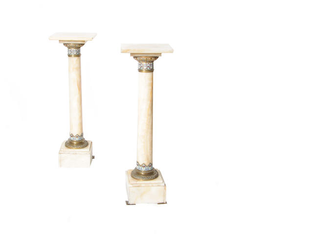A pair of French alabaster and champlevé enamel pedestals