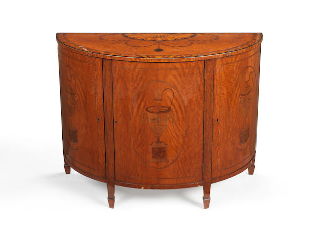 A satinwood, sycamore and harewood marquetry demi-lune commode in the manner of William Gates