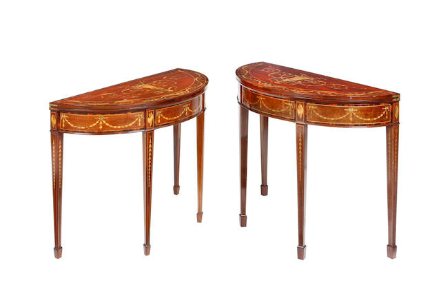 A near pair of Edwardian mahogany, rosewood crossbanded, stained sycamore and marquetry demi-lune card tables