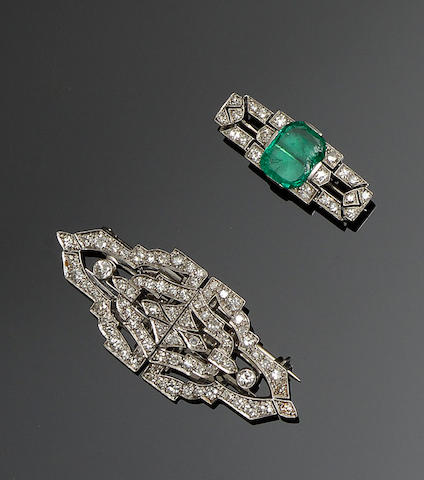 A diamond double clip brooch and an emerald and diamond panel brooch (2)