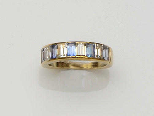 A sapphire and diamond half hoop ring