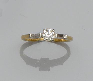 An 18ct gold single stone diamond ring