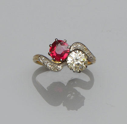 A diamond and synthetic ruby crossover ring