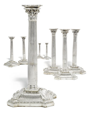Eight 18th century silver candlesticks only one with visible hallmark to base (remainder of bases filled), by Thomas Hemming, London 1756, four drip pans part marked  (8)