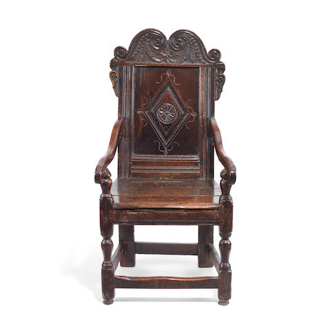 A Charles II oak panel-back open armchair Probably made in Yorkshire