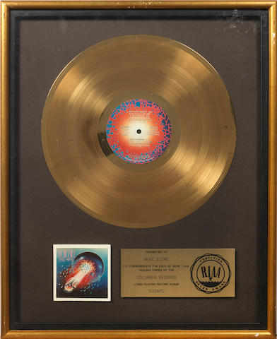 Journey: a Gold award for the album 'Escape'  presented to Mike Stone,
