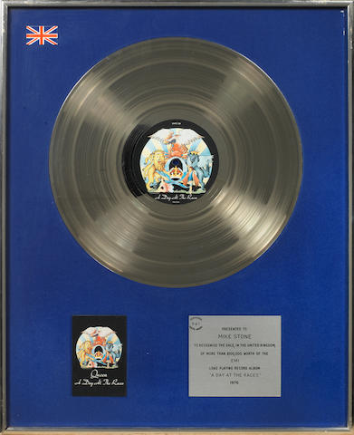 Queen: a BPI Silver award for the album 'A Day At The Races',  1976, presented to Mike Stone,