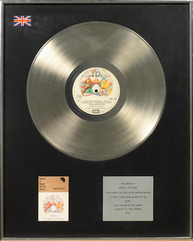 Queen: a Platinum EMI in-house award for the album 'A Night At The Opera',  1976, presented to Mike Stone,