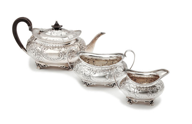 An Edwardian silver three piece tea service by Henry Atkins, Sheffield 1901