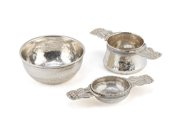 AMY SANDHEIM: A silver tea strainer and stand  (3)