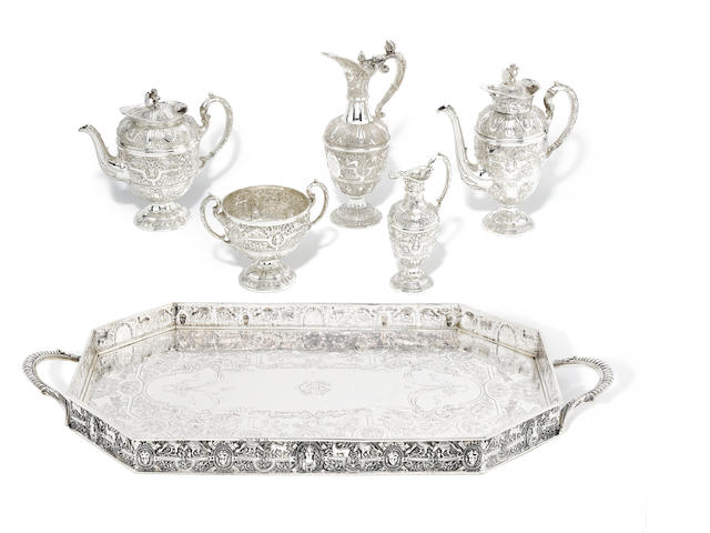"A Victorian silver four piece ""Cellini"" pattern tea service and tray by Charles Boyton, London 1891  (5)"